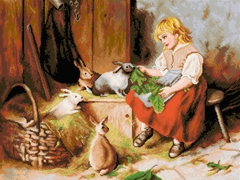 Girl Feeding Rabbits